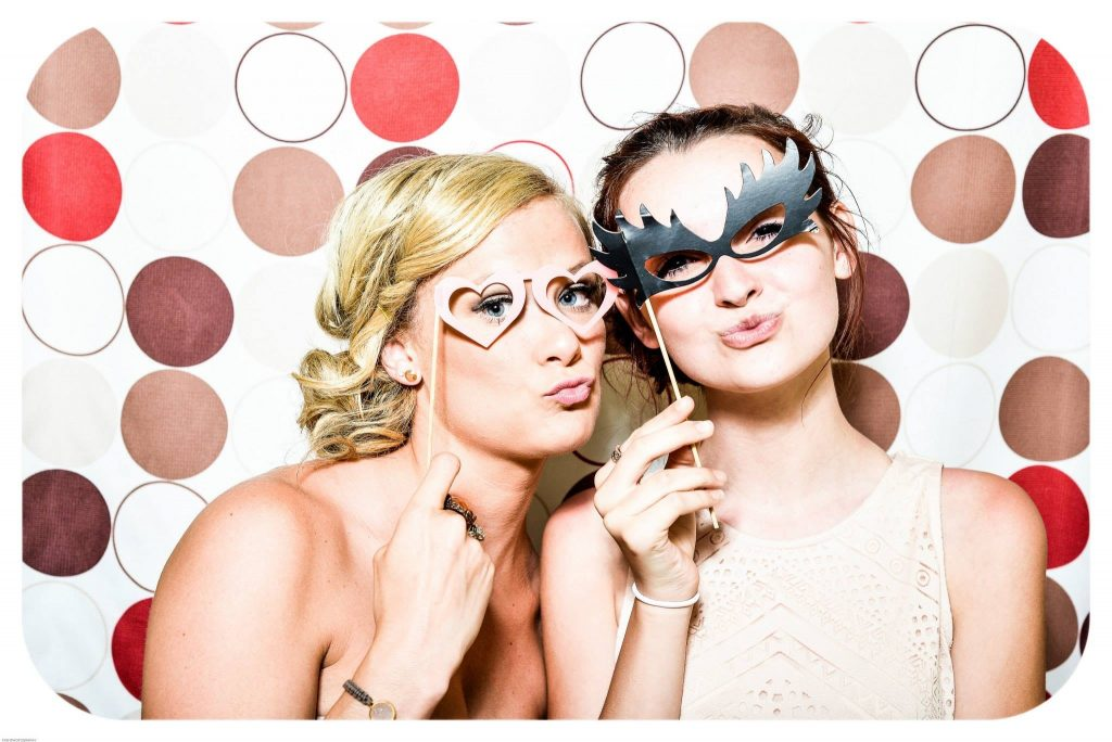Friends make funny memories in photo booth Rochester Hills
